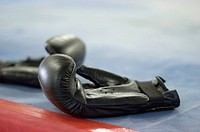 Close Up of Boxing Gloves in a Boxing Ring