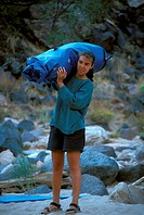 Woman Carrying Tent