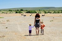 South Africa, De Hoop Nature Reserve, Mother and children watching springbok, rear view