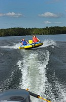 Girl and Woman Tubing on Lake, Chandos, Ontario