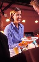 Happy Waitress Serving Dessert