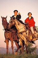 Father and Son Riding Horses Together