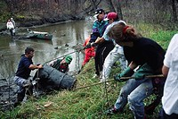 Volunteers Remove Oil Drum from Seine River, Winnipeg, Manitoba