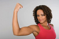 African woman flexing biceps
