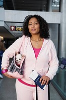 African woman with small dog at airport