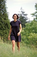 Happy Woman Walking Through Field
