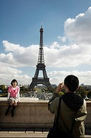 Tourists Photographing the Eiffel Tower, Paris, France