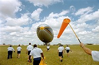 Ground Crew Stabilizes the Goodyear Blimp to provide Aerials for Coverage of the Pan Am Games, Winnipeg, Manitoba
