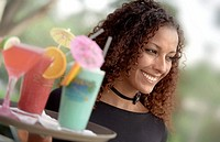 African American Waitress Holding Tray of Tropical Beverages