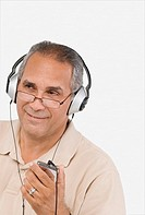 Close-up of a mature man listening to an MP3 player