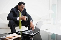 African businessman looking at laptop