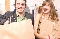 Caucasian Couple Laughing About Their Purchases At A Trendy Boutique