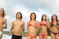 Teens Running on Beach