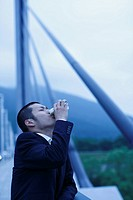 Businessman Drinking a Canned Coffee