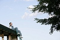 A man speaking by cell-phone on the roof