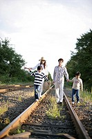 A family following the railway track
