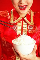 Woman with a bowl of rice