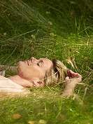 Woman lying in the grass sleeping