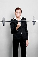 Woman lifting bar bell with fingers