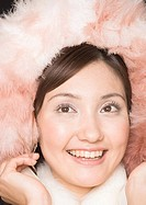 Smiling woman wearing pink fur