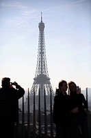 Visitors on top of Arc de Triomphe with Eiffle Tower in the background. Paris. France