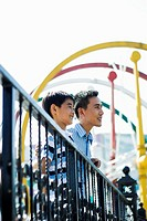 Father and son in amusement park