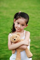 Girl hugging a teddy bear