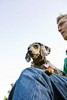 Man with Miniature Dachshund