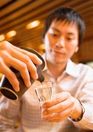 Man Pouring Japanese Sake