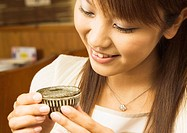 Woman Having a Japanese Sake
