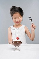 Young girl 8-9 eating dessert