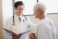 Doctor with patient and open file