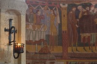 Carolingian frescoes on wall with candle at St John´s Monastery
