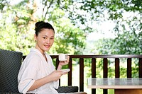 Woman enjoying a cup of tea on the balcony