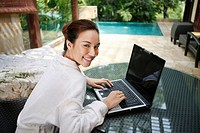 Woman in bathrobe using laptop