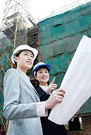 Businesswomen having discussion at construction site