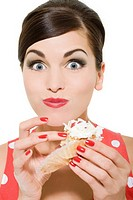 Woman eating a cream cake
