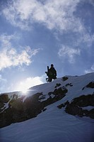Snowboarder Standing on Mountain