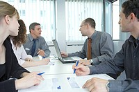 Businesswomen and businessmen discussing in meeting