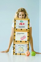 Woman standing behind crates of produce