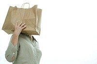 Woman carrying shopping bag on shoulder
