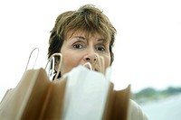 Woman looking over shopping bags