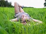 Woman resting in a green field