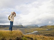 Female Hiker Stood in Open Landscape
