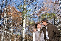 Portrait of a couple surrounded by trees