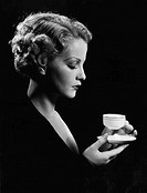 Portrait of woman with beverage All persons depicted are not longer living and no estate exists Supplier warranties that there will be no model releas...
