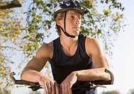 Portrait of cyclist with helmet and bike