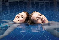 Man and woman floating in a pool