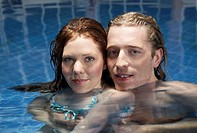 Portrait of a man and woman in a pool
