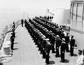 Sailors at attention on naval ship All persons depicted are not longer living and no estate exists Supplier warranties that there will be no model rel...